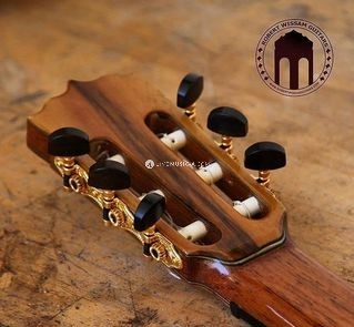 Special custom head-plate design with ebony tuning machines