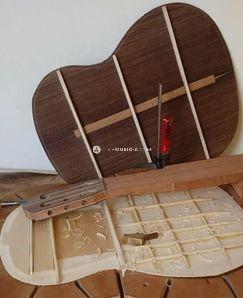 German spruce guitar top with lattice bracing... Rosewood back... Guitar parts