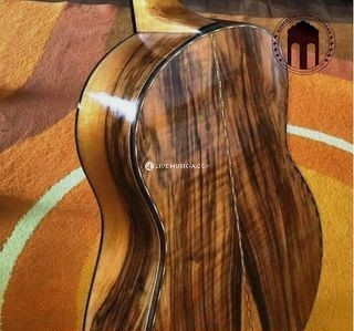 Heartwood Walnut back and sides natural grain with marquetry purflings and back strip