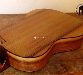 Left handed straight grain Heartwood walnut Flamenco guitar with special cutaway design...