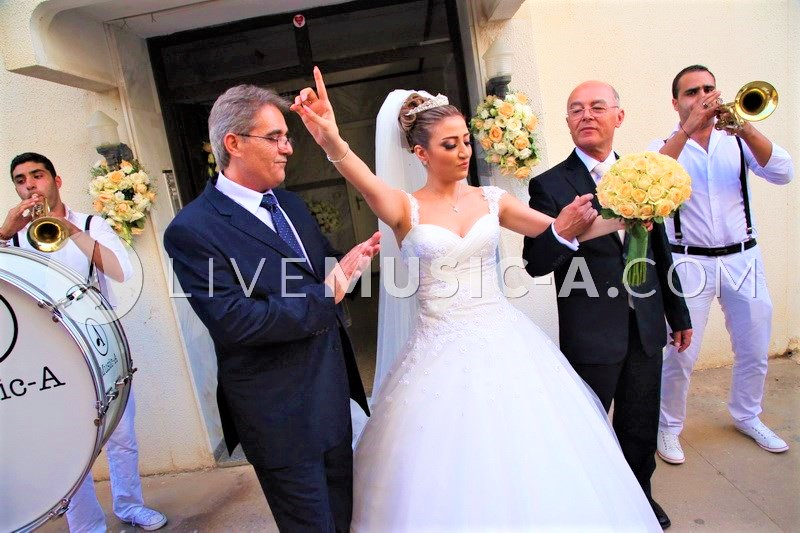 Dancing before the bride's house in Beirut with the parade