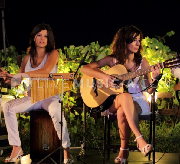 Ladies on the guitar and percussions