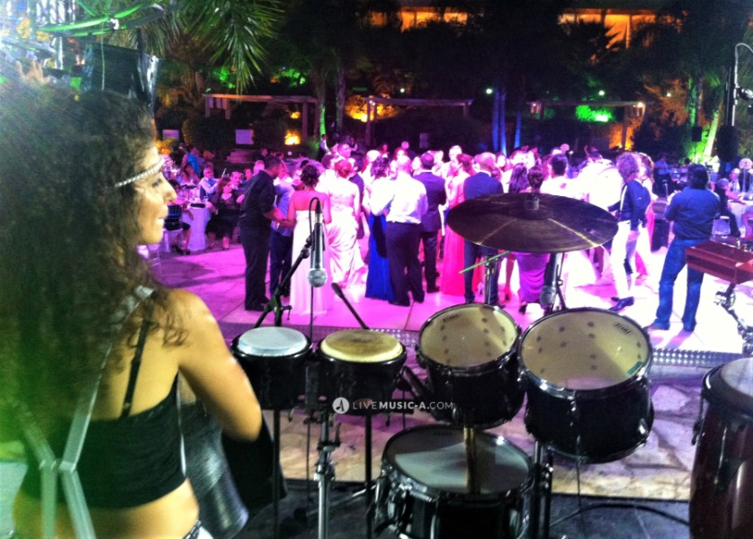 NG on her upright drum set & percussion at the wedding venue in Ghazir Michael's Garden