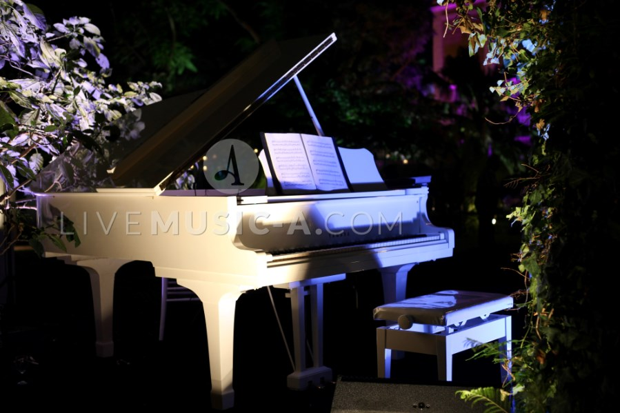 White baby grand piano at sursock the gardens