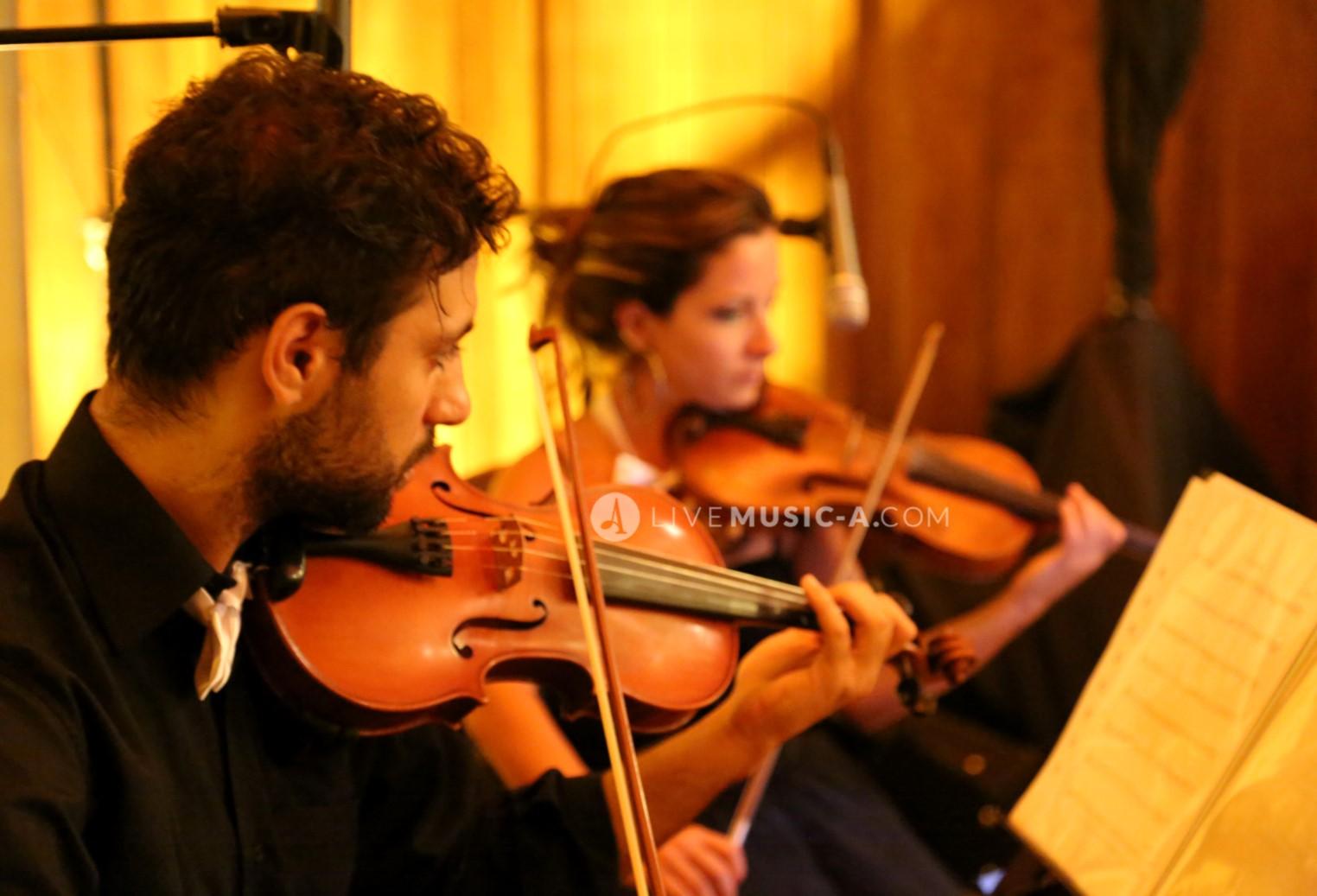 Violins performing at Villa Linda Sursock
