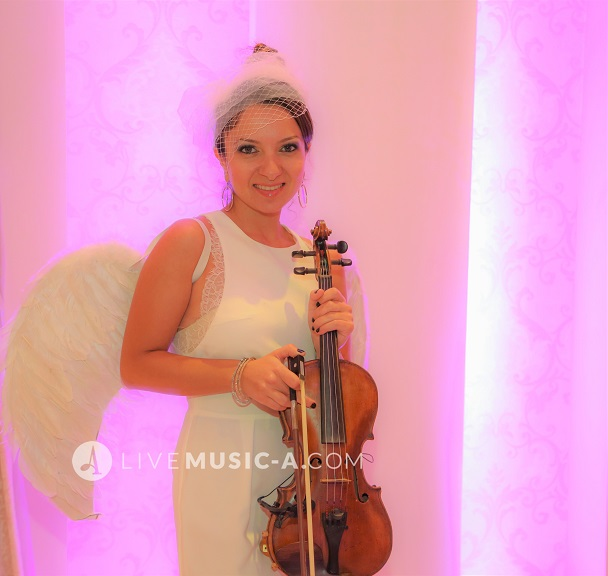 violinist with wings all in white