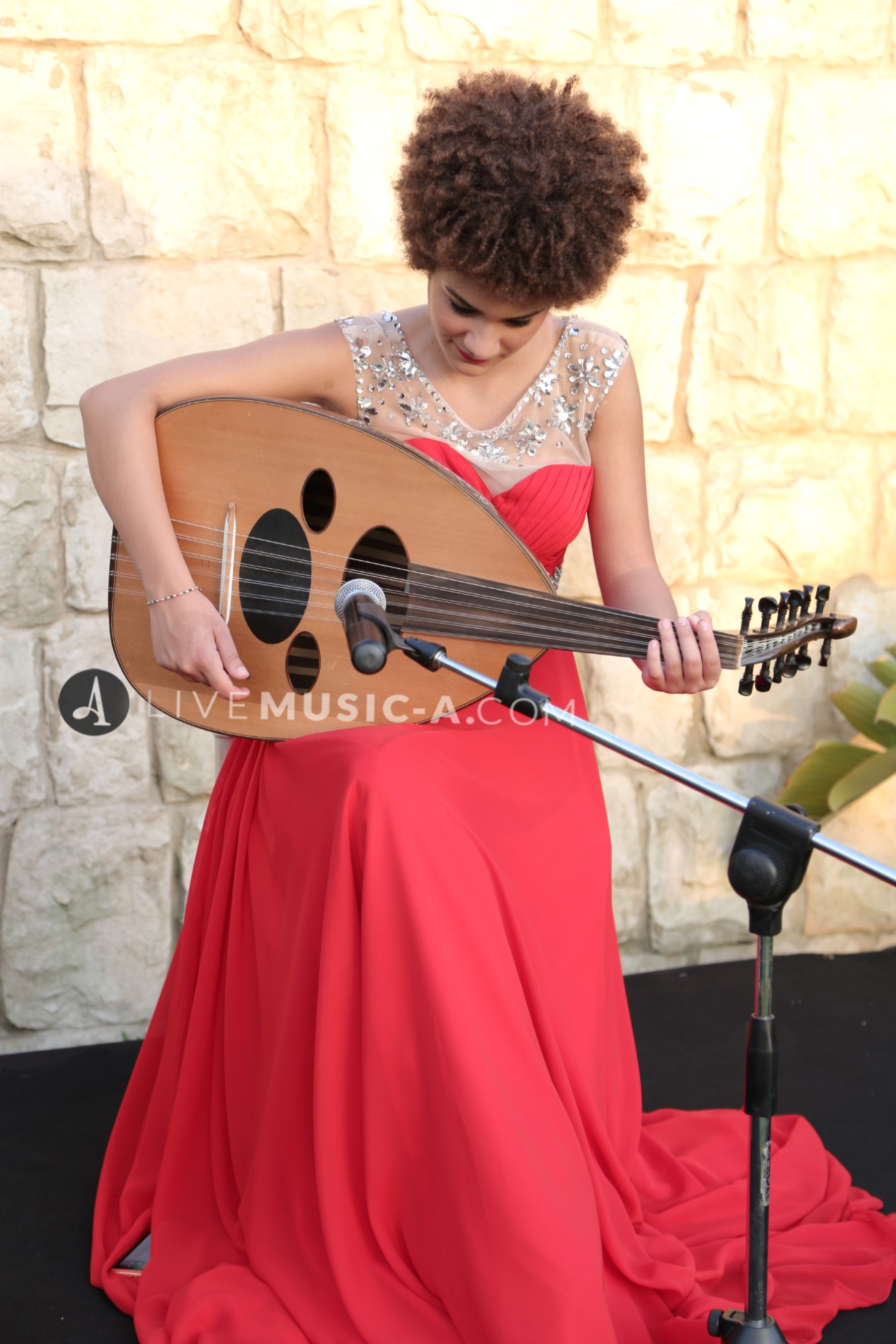 Female Oud Player - Red Dress