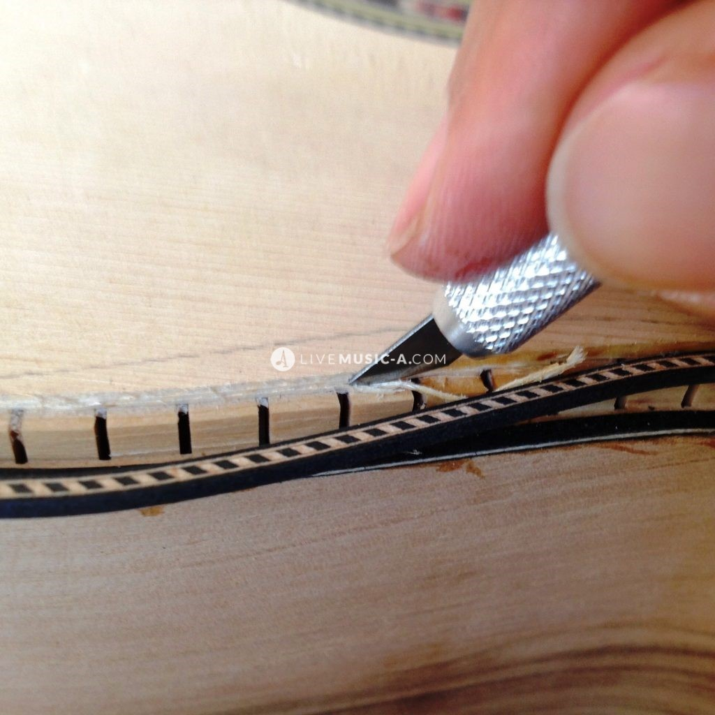 Inserting marquetry and bindings... Binding and marquetry designs.